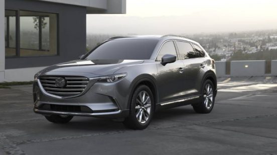 Image of a silver 2019 Mazda CX-9 parked in a driveway.